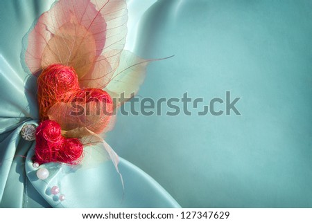 Blue satin cloth with red hearts and empty space for your text - stock photo