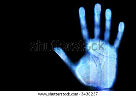 Blue scanned hand - future and internet protection concept - stock photo