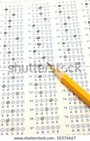 Blue Scantron Bubble Test with number two yellow pencil. - stock photo