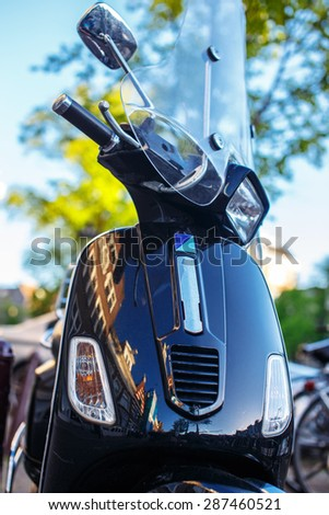 Blue scooter on the city street. - stock photo