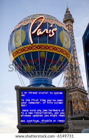 Blue screen sign critical error on Paris hotel sign - stock photo