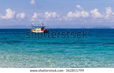 blue sea and a small fishing boat. Malaysia.