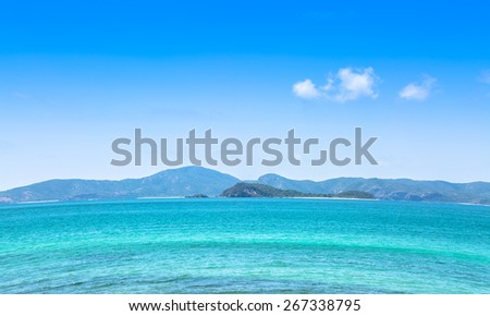 Blue sea and big island in sunshine day in summer - stock photo