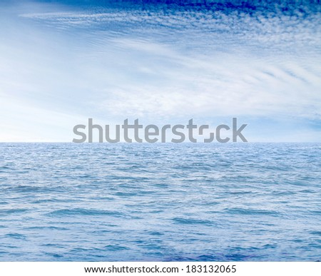blue sea and clouds on sky - stock photo