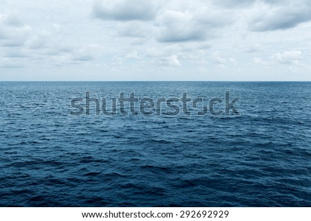 blue sea and cloudy sky waves in Atlantic Ocean - stock photo