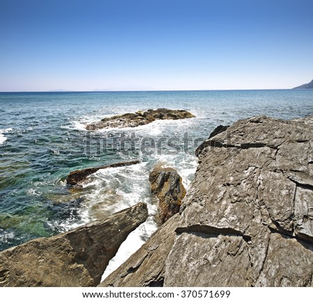 blue sea and sky and stones