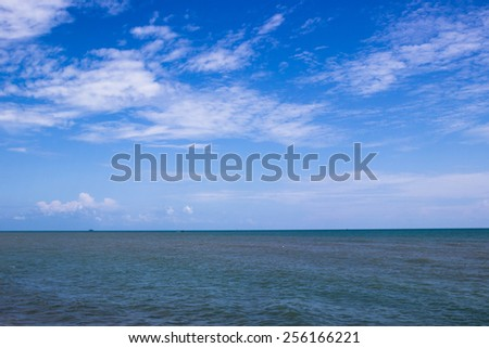 Blue sea and sky background with white clouds