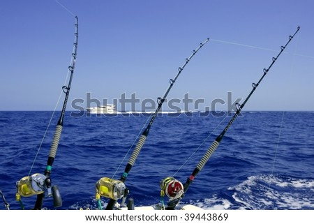 Blue sea and sky in a big game tuna fishing day rods and reels on boat.