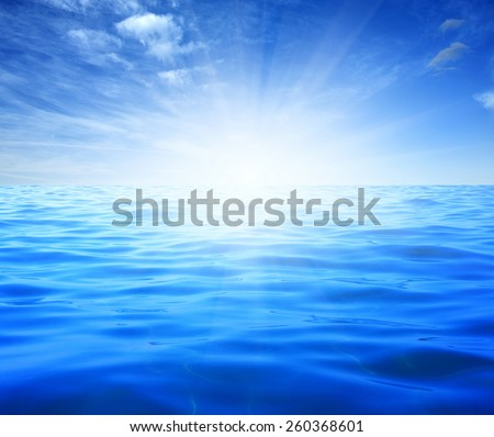 Blue sea and sun on sky - stock photo