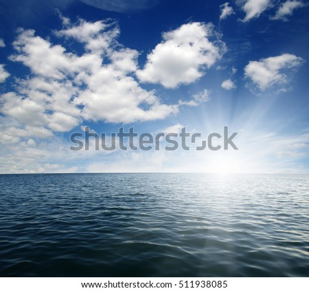 Blue sea and sun on sky
