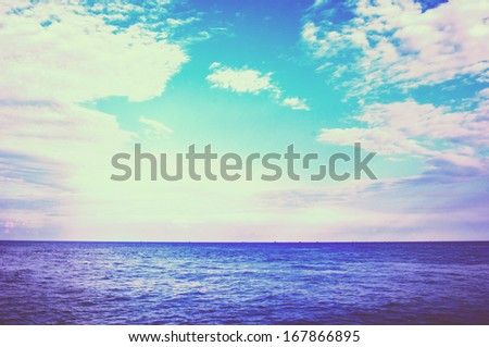 Blue sea in retro and vintage style.  - stock photo