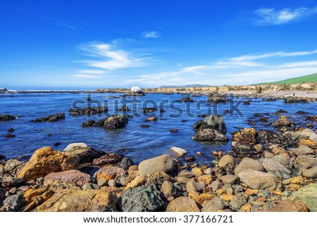 Blue sea & sky,Tide pools, rock and geological formations along the rugged coastline of Estero Bluffs sate park. Traveling the Big Sur Highway (Highway 1), California Central Coast. - stock photo