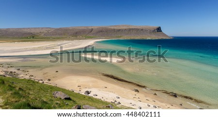 Blue sea water at a beach at Patreksfjordur at the west fjords of Iceland - stock photo