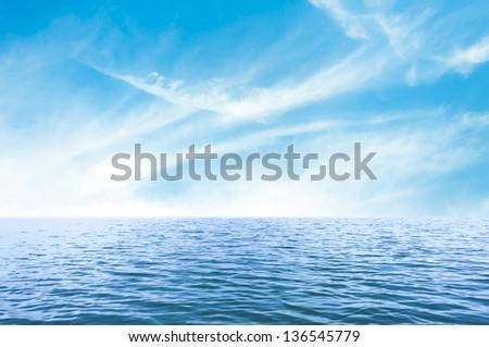 Blue sea with blue sky. - stock photo