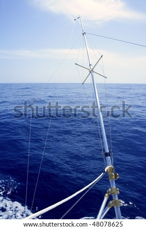 Blue sea with outrigger fishing boat equipment to spread wide the fishing lines
