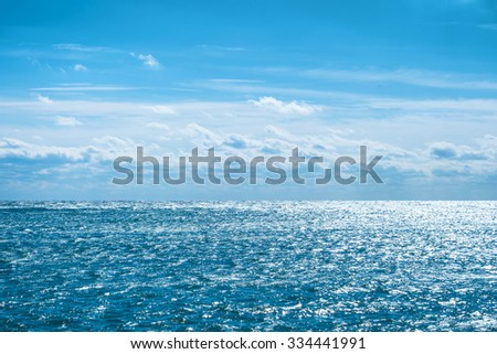 Blue sea with sky and clouds. Water natural background - stock photo