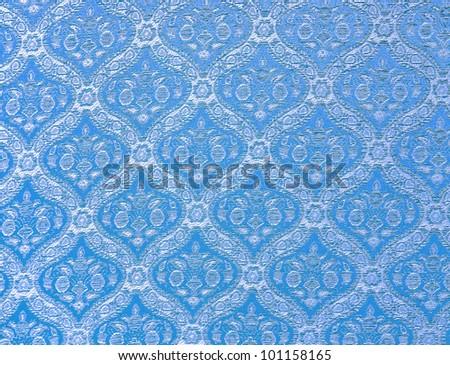 Blue seamless Thailand pattern on fabric - stock photo