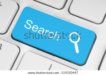 Blue search button on the keyboard close-up