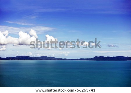 blue seascape with remote mountains on horizon. Thailand Island