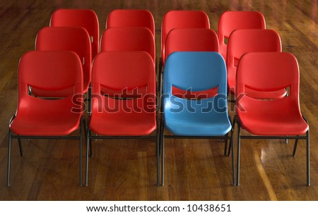 blue seat amongst red - stock photo