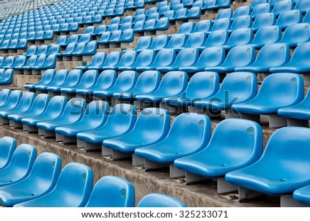 Blue seats in a section of a stadium