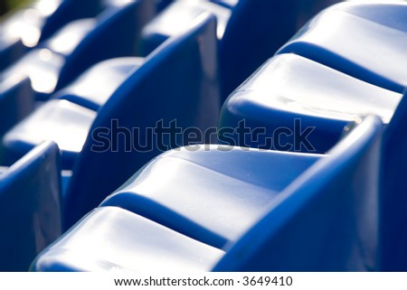 Blue seats in a sports stadium