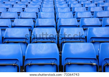 Blue seats in row on stadium - stock photo