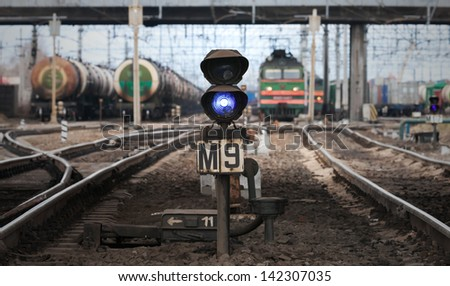 Blue semaphore lights on modern cargo railway - stock photo