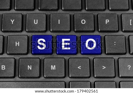 blue SEO or search engine optimization word on keyboard - stock photo