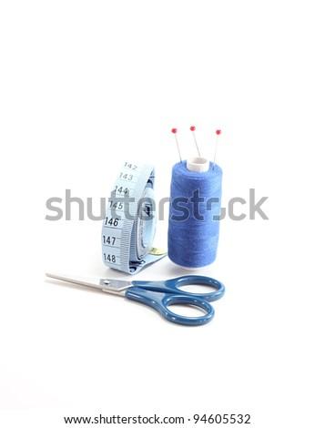 blue sewing kit isolated on white background - stock photo