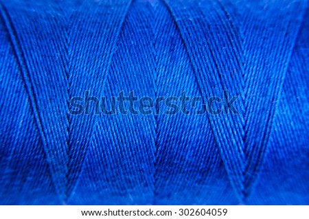 Blue Sewing thread background - stock photo