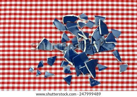 blue shards lying on table - stock photo