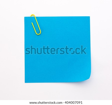blue sheet of paper with yellow paper clip on a white background - stock photo
