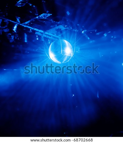 blue shining disco ball in a disco