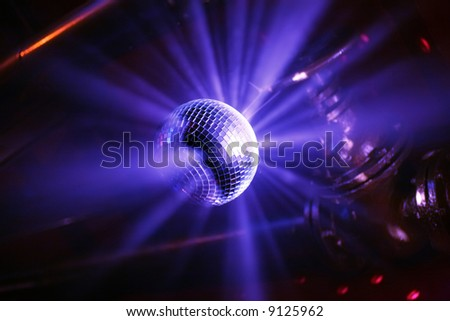 Blue shining discoball / mirrorball in motion - stock photo