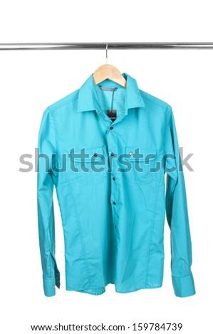 Blue shirt on hanger isolated on white - stock photo