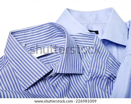 Blue shirt on white close up - stock photo