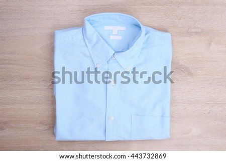 Blue shirt on wooden background