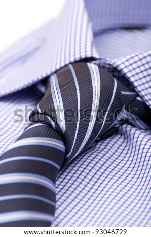 Blue shirt with a tie macro - stock photo