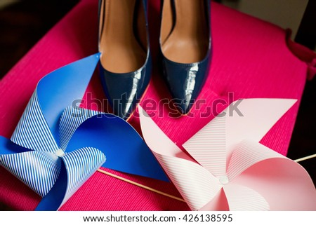 blue shoes and pink and blue pinwheels - stock photo