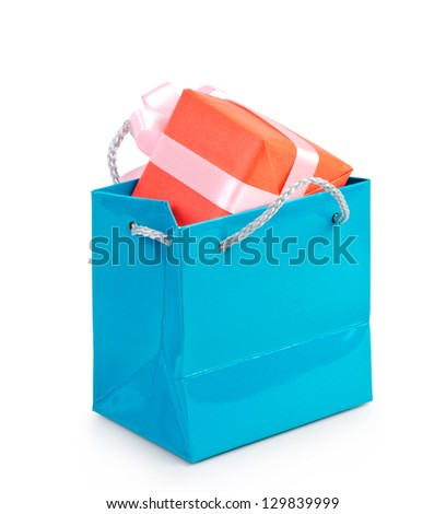 Blue shopping bag with gift on white background