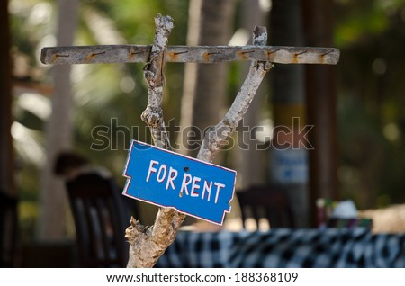 blue sign For rent on the wood - stock photo