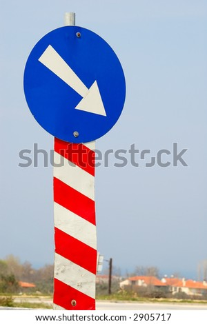 Blue sign with arrow pointing right - stock photo