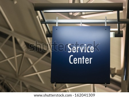 Blue Signage Marks the Customer Service Center in a Public Building Shopping Structure - stock photo