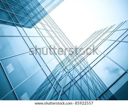 blue silhouettes of high rise skyscrapers at night - stock photo