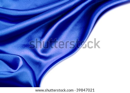 Blue silk material on white background. Copy space - stock photo