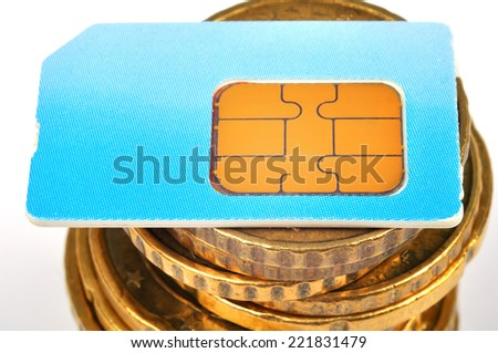 blue sim card and euro coins money, close up - stock photo