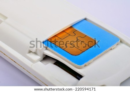 blue sim card in modem isolated on white background - stock photo
