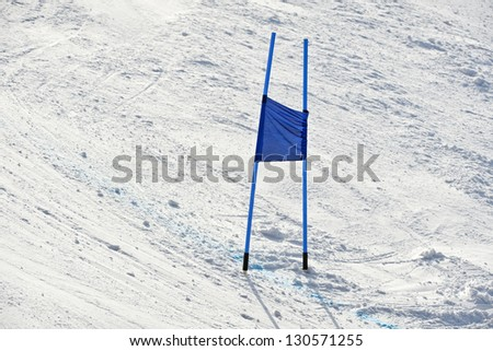 Blue ski gate at giant slalom race - stock photo