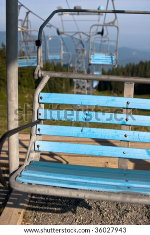 Blue ski lift in summer - stock photo